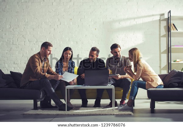 Business people connected on internet network with a laptop in a relax room. concept of startup company