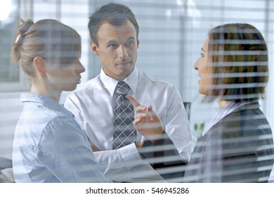 Business people conversing in office