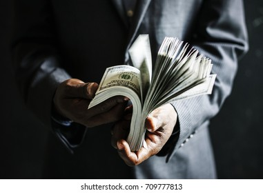 Business people counting money on his own hand