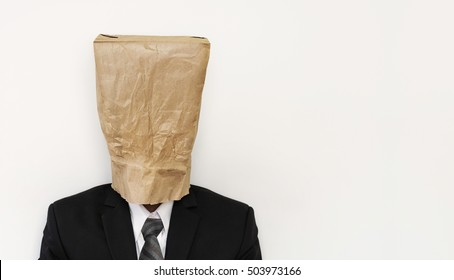 Business people with crumpled brown paper bag on head, with copy space