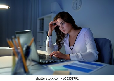 business, people, deadline, stress and technology concept - businesswoman with laptop at night office