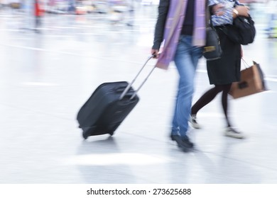 business people departure with luggage at airport