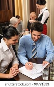 Business people discuss reports management meeting at restaurant conference room