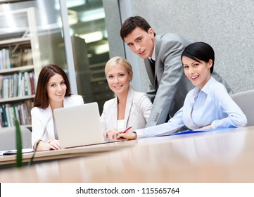Business people discuss something at the meeting at the modern office building. Success concept