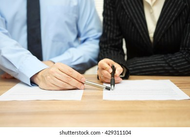 Business people discussing about contract, manager pointing on content in document