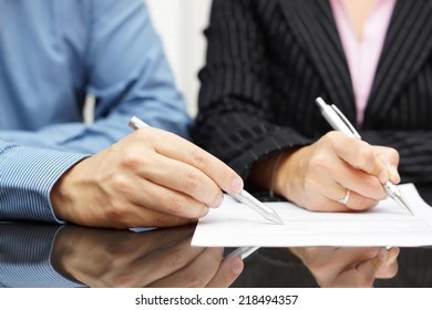 Business people discussing about a document