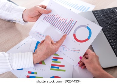 Business people discussing about financial results