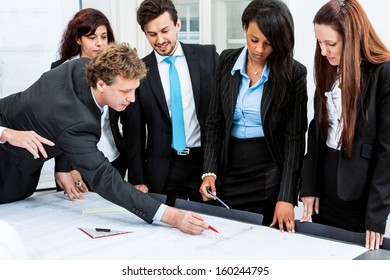 business people discussing architecture plan sketch in office