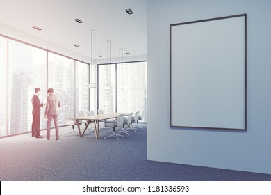 Business people discussing company strategy in modern office conference room with a long wooden table and armchairs. Business success concept. Vertical copy space banner toned image