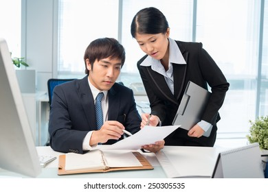 Business people discussing document