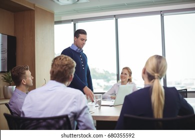 Business people discussing during meeting in board room