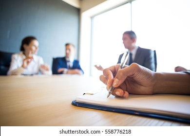 Business people discussing in meeting at conference table in office
