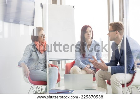 Business people discussing in meeting room