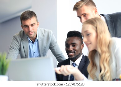 Business people in discussing something while sitting together at the table. - Shutterstock ID 1259875120