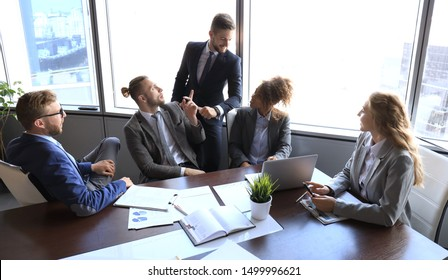 Business people discussing together in conference room during meeting at office