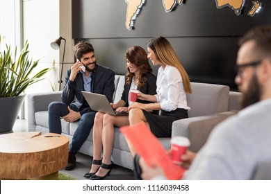 Business people discussing work related matters and working in a modern office building