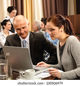 Business people discussion woman look laptop at restaurant conference room