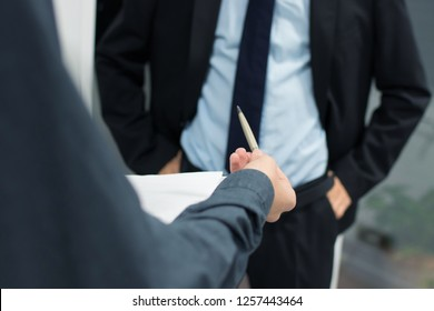 business people with documents and signing the contract