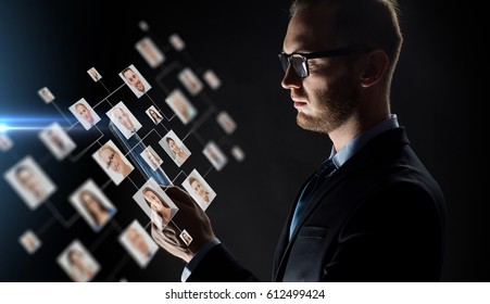 business, people, employment, hiring and future technology concept - close up of businessman with transparent tablet pc computer and contact icons over black background