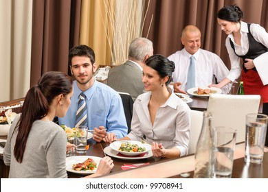 Business people enjoy lunch meal at restaurant management discussion