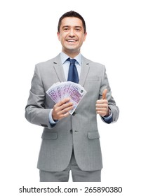 business, people and finances concept - smiling businessman with european money showing thumbs up
