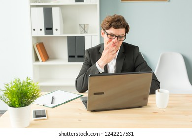 Business people, fun and joke concept - funny businessman picking his nose in office space