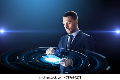 business, people and future technology concept - businessman in suit working with transparent tablet pc computer and virtual projection over black background