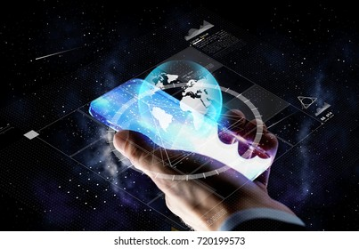 business, people and future technology concept - close up of businessman hand with  smartphone and virtual earth projection over space background