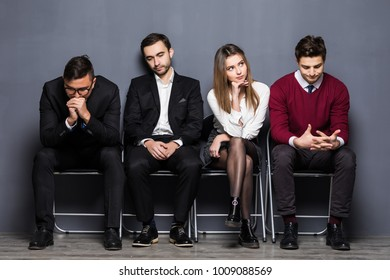 Business People Are Getting Bored While Sitting On Chair Waiting For Job Interview