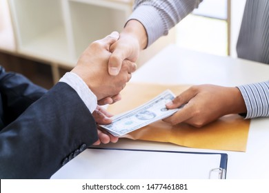 business people giving bribe money in an office.