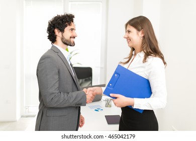 Business people giving an handshake