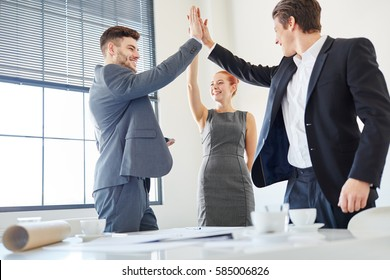 Business people giving High Five as motivation for success