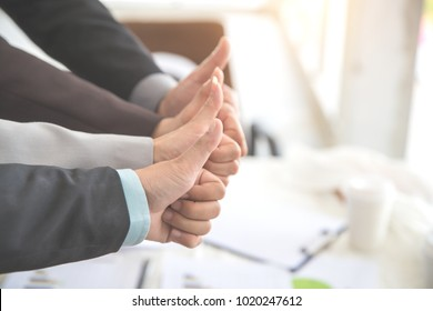 business people giving thumb up after completed project during meeting using as background (concept of teamwork and partnership)