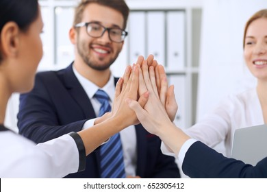Business people group Business people group happy showing teamwork and joining hands or giving five after signing agreement or contract in office