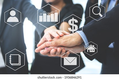 Business people group join the hand for collaboration team work and support with business icon for  business concept - Shutterstock ID 1936846291