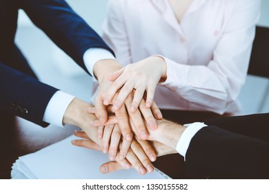 Business people group joining hands. Teamwork or meeting concepts