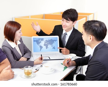 business people group meeting with finger point world map in computer screen at office, asian people