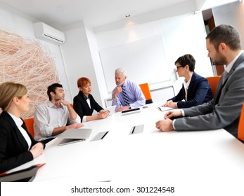 business people group on meeting at modern bright office indoors. Senior  businessman as leader in discussion.