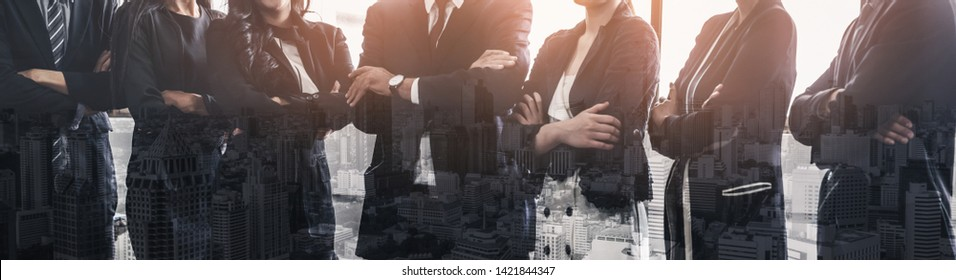 Business people group standing together with city office building background double exposure. Modern corporate job and human resources recruiting concept.