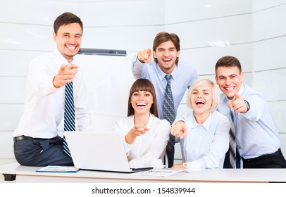 Business people group team point finger at you, Successful excited young businesspeople happy smile at office desk