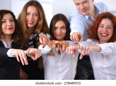 Business people group team point finger at you