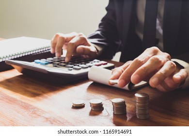 Business people, Handles coins placed on a pile of money saving on the table. Business finance concept.