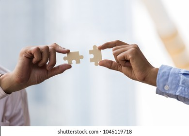 Business people hands connecting puzzle.Business teamwork concept.