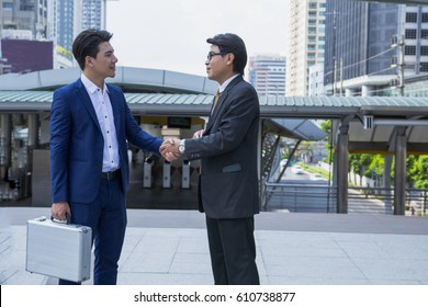 Business people hands shaking for welcoming business partners