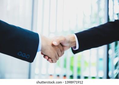 business people handshaking after good deal