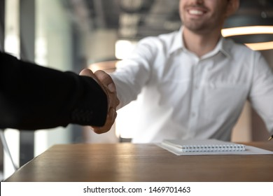 Business people handshaking, making successful deal, partnership agreement, close up, har manager greeting job applicant during interview in office, businessman shaking hand of partner at meeting