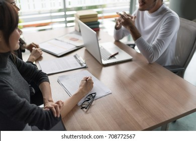 Business people have a meeting with presentation in office, they negotiate a contract.New project interview concept.Businessman explaining and listen to parnership answers. Setup studio shooting.