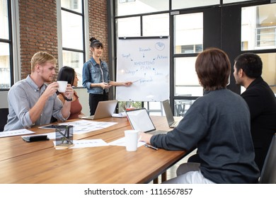 Business people have meeting together at office. Woman present the project with happy emotion. People working together with casual style at modern office.