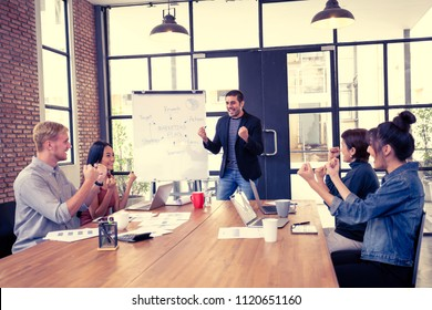 Business people have meeting together at office. Businessman present the project with happy emotion. People working together with casual style at modern office.  Vintage tone.