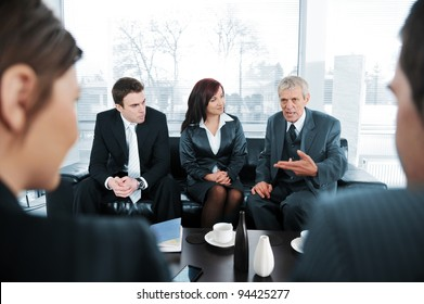 Business people  having coffee at office meeting